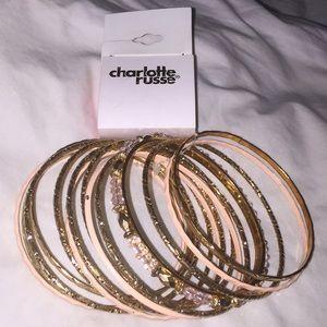 Charlotte Russe gold and orange bracelet set.